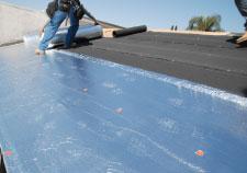 Ryan Construction Contractor installing an Underlayment mat